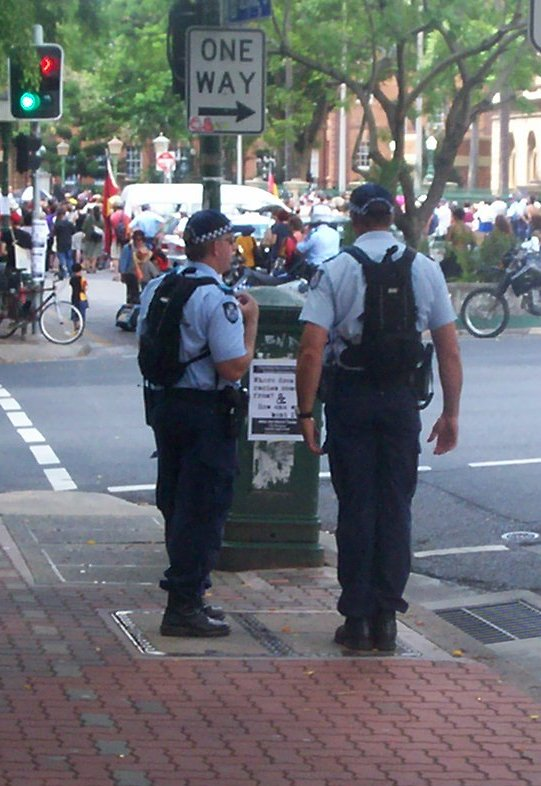Police on corner of George and Alice Sts, opposite Parliament House - Invasion Day rally, Brisbane, Queensland, Australia-1 070126