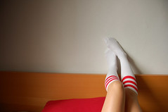 Knees (j.fralin) Tags: socks interestingness girlfriend stripes naturallight moo explore personalfavorite americanapparel knees huong lazysunday stripeysocks stripedsocks kneehigh redbedpillow fatgirlsguidetolivingcom