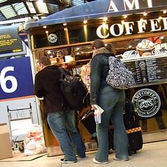 off on our hols (jovike) Tags: city people london coffee station retail railway jeans kiosk kingscross