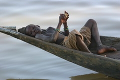 Lazy days ... (Ferdinand Reus) Tags: africa travel water niger river children boat kid young lazy mali relaxed bozo djenne mopti afrique  blueribbonwinner timbouctou piroque