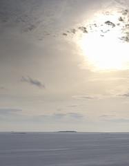 frozen globe (joskerrr) Tags: winter sea sun snow seascape ice clouds geotagged island frozen 59points