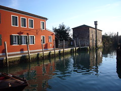 red house and canal in torcello island