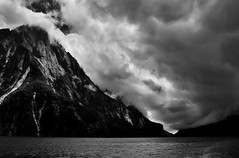 The Storm Approaches (red321) Tags: newzealand blackandwhite clouds conversion milfordsound stormclouds december2003 aroundtheworld fjordlandnationalpark powerretouche impressedbeauty utata:color=black scanfromfilmnegative redinkphotography allrightsreservedseanscanlon utata:project=uplandscape