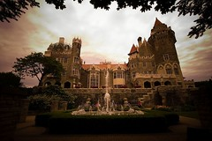 Casa Loma Sunset Effect (Somewhere In Toronto) Tags: trees sunset orange toronto ontario canada building brick tourism water fountain gardens photoshop buildings effects moody dramatic wideangle 2006 specialeffects naturalframing specialfx casaloma torontoist somewhereintoronto blogtofffconsideration