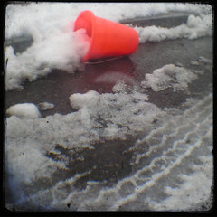 Orange Pail on the Side of the Road (Mixxie Sixty Seven) Tags: winter orange snow trash catchycolors toys bucket junk pavement slush litter plastic february pail tiretread ttv veiwfinder throughtheviewfinder discardedtoys thecolororange