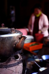 tea time. (theshanghaieye) Tags: china pink vacation food holiday kitchen restaurant asia tour tea chinese cook tourist pot kettle backpacking lonelyplanet  yunnan backpacker lijiang province teakettle nationalgeographic dayan    middlekingdom
