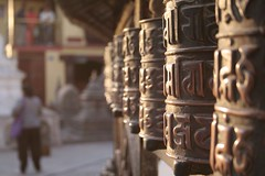 Prayer wheels (33 East) Tags: nepal 20d canon temple eos monkey dusk prayerwheels swayambhunath budhhist