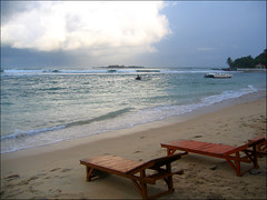 a beach in waiting (ladyinpink) Tags: light sea beach freedom sand heat tropical srilanka nothing deckchairs unawatuna