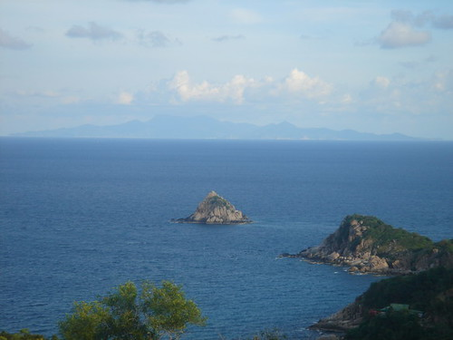 View over Lang Khaay, Ko Tao, Ko Pha Ngan's shadow in distance