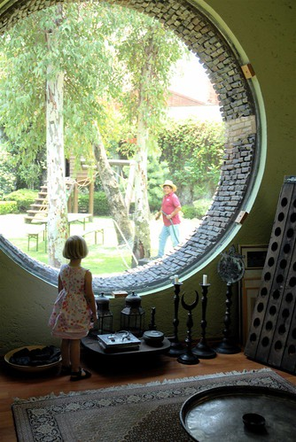 Pauline looking out of round window
