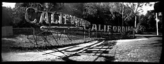 californian. los angeles, ca. 2006. (eyetwist) Tags: california park camera longexposure light bw panorama white black 120 film monochrome sign analog vintage mediumformat typography mono hotel la blackwhite words losangeles los neon angeles handmade pano text wide rusty wideangle panoramic ishootfilm pinhole company socal 200 rusted transparency signage type scala medium format analogue griffithpark griffith agfa derelict dtla southland californian homebuilt mdf typology typographic emulsion horsley angeleno panopin eyetwist f190 panpin horsleycameraworks mikerignall 110º filmexif eyetwistkevinballuff curvedfilmplane horsleycameracompanypanopin pinholef190 signgeeks