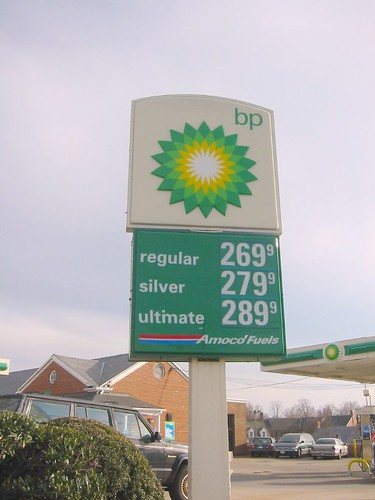 the sign at a BP gas station showing gas prices