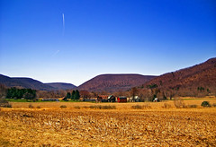 Brazen (Nicholas_T) Tags: sky field rural landscape spring contrail pennsylvania farm brightlight valley creativecommons cloudless appalachianmountains pottercounty route6 usroute6 pennsylvaniawilds alleghenyplateau roulettetownship