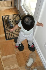 Trying on daddy's slippers