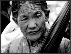 A lady with an umbrella (Sukanto Debnath) Tags: portrait blackandwhite woman india sony ethnic f828 sikkim debnath ravangla superaplus aplusphoto sukanto sukantodebnath