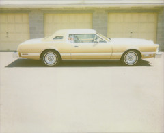 for sale (jena ardell) Tags: car yellow polaroid gold automobile forsale pavement garage wheels tires polaroidspectra spectra sideview tbird fordthunderbird jenaardell