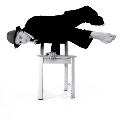 break dance (Lumatic) Tags: shadow portrait people blackandwhite music woman art feet topf25 girl hat fashion silhouette youth contrast pose studio foot frozen dance movement model chair eyecontact toes toe break power dancing emotion artistic action contemporary air leg performance young picture bodylanguage dancer clear negativespace wicked freeze portraiture strong balance highkey hiphop strength handstand rap breakdance conceptual onwhite emotive bnw fac bgirl whiteground hikey onefoot freezed airchair bodysculpture flatbackandcry bgirling stuhlbeine frozeninaction
