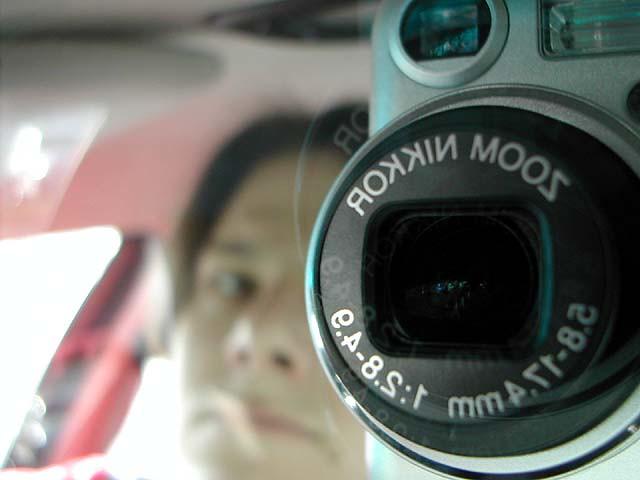 camera reflection car mirror fresno nikoncoolpix775 november172001 1996dodgeintrepid