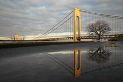 Verranazi Puddle Reflection (JB Photo) Tags: bridge usa ny architecture reflections blog unitedstates statenisland verrazano verrazanonarrows newyorkharbor
