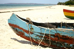 saturation (Farl) Tags: africa travel sea beach water colors boats coast boat sand peeling paint gutentag horizon traditions rope madagascar diegosuarez antsiranana emeraldsea putrigger merdemeraude