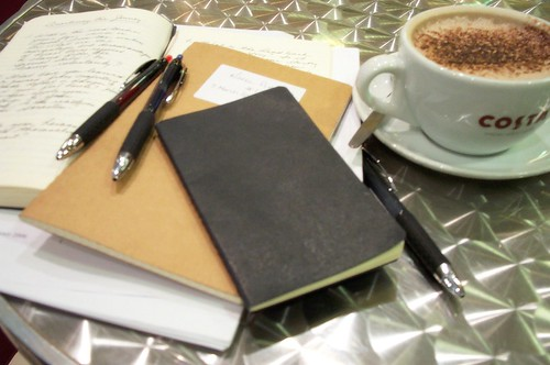 Coffee and Moleskine III (color) by Lost in Scotland.
