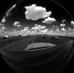 commute (Capital I) Tags: road arizona bw car topv2222 clouds fantastic highway topf75 googlemaps pavement highcontrast convertible fisheye freeway bmw scottsdale asphault topi weitwinkel capitali loop101 weatherstripping ngulolargo top20fisheye bmwmagazine ianschlueter nikonstunninggallery