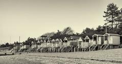 Wells Huts (Geoffrey Tibbenham) Tags: north northnorfolk coast beach huts sunset sky monochrome blackandwhite fuji 1855mm