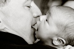 11 days old (-Angela) Tags: boy blackandwhite baby topf25 canon daddy infant kiss profile 2006 notmykid newborn client familygallery