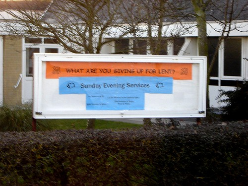 funny sign in front of a church, asking 'what are you giving up for Lent?' and the message below it, tells of 'Sunday Services'