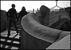Ha'penny Bridge, Dublin (Steve-h) Tags: bridge ireland dublin woman man lines mono shadows legs curves steps silhouettes lovers line granite holdinghands ironwork allrightsreserved thebigone supershot 11f leadin 354v steveh