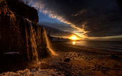 (iJohn) Tags: ocean sunset sea lighthouse ice beach river golden waterfall bravo novascotia wharf silky blueribbonwinner abigfave superbmasterpiece goldenphotographer margretesville