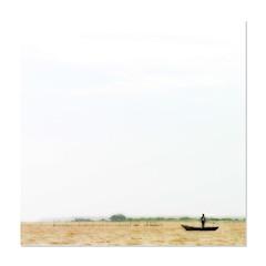 Expanse (Java Cafe) Tags: sky india lake man water landscape boat bravo solitude space f10 orissa expanse chilka