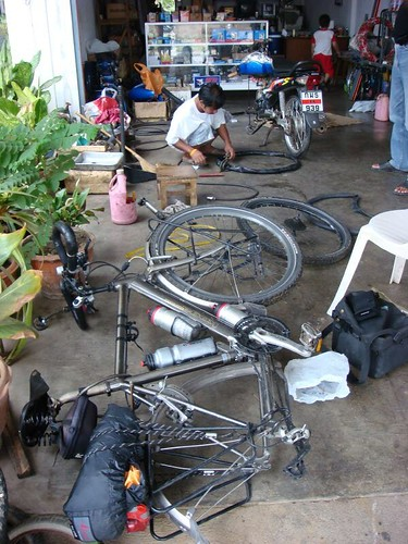 Fixing the flat tyre, Thai style.