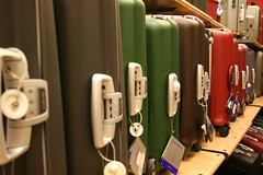 Multicolor suitcases (jepoirrier) Tags: blue red brown green catchycolors grey shelf suitcase