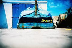 old boat (lomokev) Tags: wood blue boat lomo lca xpro lomography crossprocessed xprocess madera low ground lomolca morocco numbers agfa holz jessops100asaslidefilm agfaprecisa essaouira lomograph agfaprecisa100 cruzando afica precisa ratseyeview jessopsslidefilm file:name=070510lomolcapluse086 ξυλο