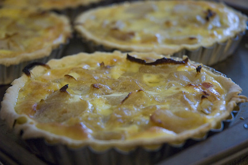 caramelized onion and apple tarts with pancetta and aged cheddar