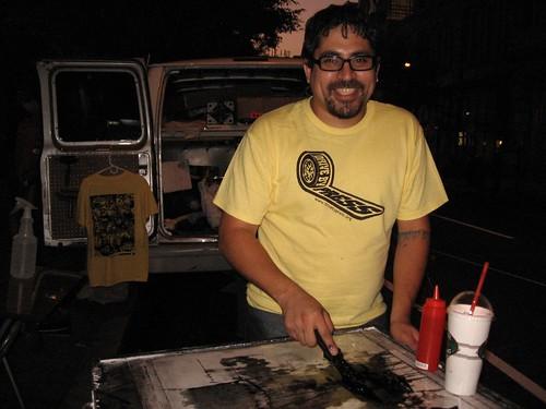 "Joseph Velazquez printing ""in the gutter"" (Arch Street)"