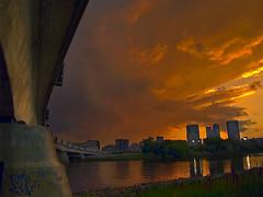 Alone (Paul Linton) Tags: bridge sky sun canada storm set clouds winnipeg olympus manitoba zuiko