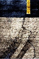 Hurry (KarenPierson) Tags: road abstract yellow dark pavement grain bank crack loveit skid whothehellcares loveitloveitloveit fromtheparkinggarage blueberrymom mostwont invertedcurve