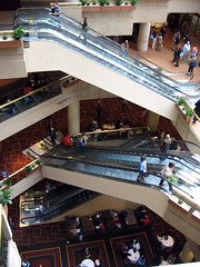 Librarians on escalators in the Hyatt lobby