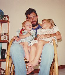 A rocking chair on Guam in 1988 with Abbey in blue, on my right...