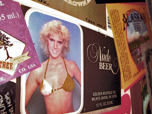 Nude Beer. A scratch-off ad for a pervy beer, one of the wall decorations at ...