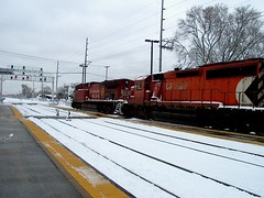 Eastbound Canadian Pacific freight train passing through the suburban River Grove Illinois Metra commuter rail station. Photographed on December 1st  2006, after the snowstorm stopped falling.