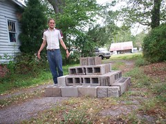 Luca Masters next to his cinderblock pyramid.