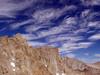 Sky High (acastellano) Tags: blue sky mountain mountains topv111 clouds rocks hiking explore backpacking whitney granite wilderness sierras mountwhitney sierranevada range muir elevation40004500m interestingness175 mountainssierranevada altitude4418m summitmtwhitney summitmtmuir altitude4271
