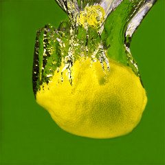 Lemon (Sesselja Mara) Tags: food green wet water yellow closeup fruit speed juicy lemon healthy movement close pad fresh health photoaday taste citrus diet splash sour fruity freshness highspeed nutrition splashing naturesfinest healthiness sesseljamara