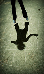 Hop - shadow (a moment in time) (s0ulsurfing) Tags: light shadow game texture beautiful silhouette composition dark fun fly chalk fantastic jump bravo shadows child play ground gravity getty eden hopscotch hop draw float simple edie leap 2007 freshwaterbay outstandingshots s0ulsurfing abigfave
