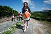 07145D6343 (Paulgi) Tags: street party portugal girl book europe village photoblog drummer outtake pilgrims romeiros minho 17mm paulgi soutelo freixieiro romeirosouttakes