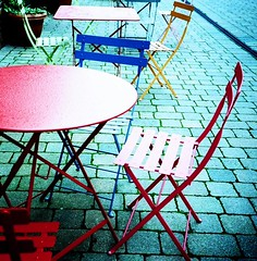 holga have a seat (Baby Skinz) Tags: blue red colors yellow holga lomo xpro crossprocessed colours norfolk 200asa holt agfa primarycolours picnictable tableandchairs supershot
