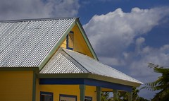 Colors of the Caymans 1 (Tony Reynes) Tags: blue green yellow clouds caymanislands tinroof